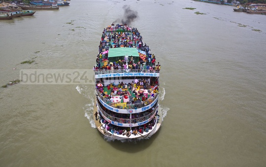 A launch leaving Dhaka with more passengers than its capacity. This photo was taken from China-Bangladesh Friendship Bridge on the Buriganga River at Postogola on Tuesday.