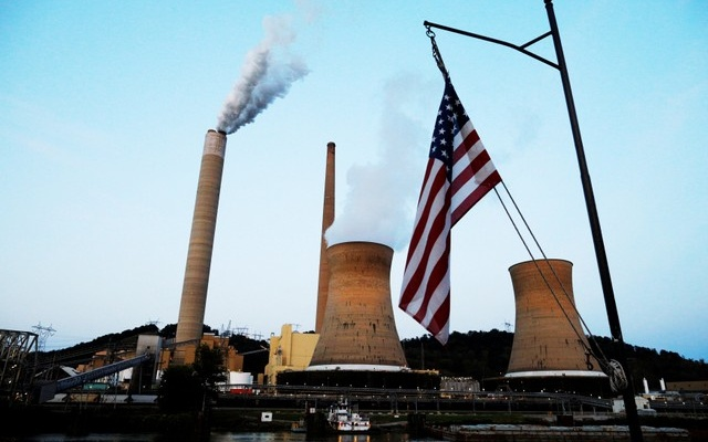 FILE PHOTO: The US flag flies on Campbell Transportation's towboat MK McNally as it passes Mitchell Power Plant, a coal-fired power-plant operated by American Electric Power (AEP), on the Ohio River in Moundsville, West Virginia, US, September 10, 2017. Reuters