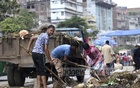City corporation workers began cleaning up Dhaka on Wednesday morning to clear waste from the cattle slaughtered on Eid-ul-Azha. This photo was taken from Old Dhaka's Bangshal. Photo: Mahmud Zaman Ovi