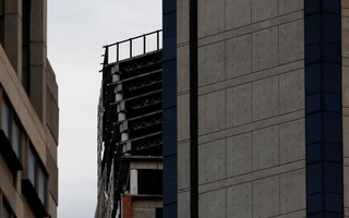 Structural damages are seen on the top five floors of an abandoned 45-storey skyscraper known as the