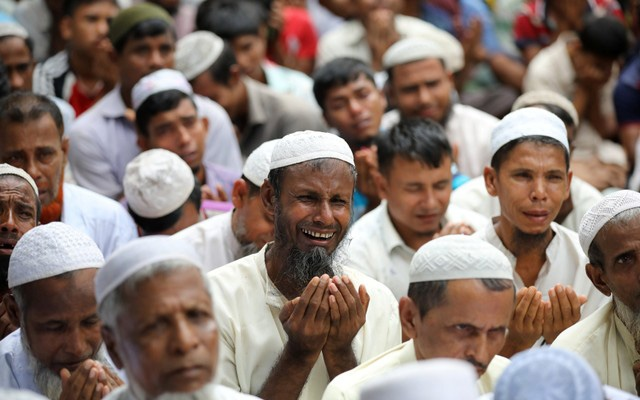 Rohingya refugees pray as they take part in a protest at the Kutupalong refugee camp to mark the one year anniversary of their exodus in Cox's Bazar, Bangladesh, August 25, 2018. Reuters