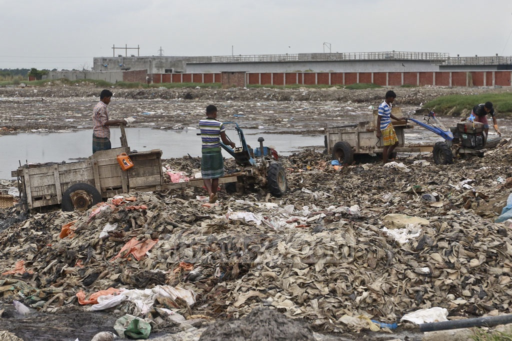 Workers dumping waste materials from tanneries at a pool at the Savar leather industry city. Photo: Abdullah Al Momin