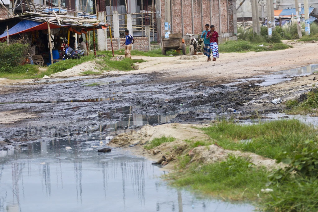 A street at the leather industry city in Savar is covered with liquid waste from tanneries. Photo: Abdullah Al Momin