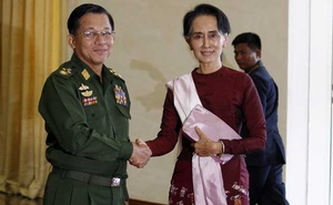 Myanmar's Commander-in-Chief Min Aung Hlaing shakes hands with National League for Democracy party leader Aung San Suu Kyi before their meeting in Naypyitaw Dec 2, 2015. REUTERS