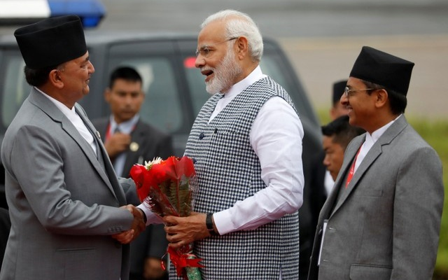 India's Prime Minister Narendra Modi shakes hands with Nepal's Defense Minister Ishwor Pokhrel upon his arrival at Tribhuvan International Airport to attend the Bay of Bengal Initiative for Multi-Sectoral Technical and Economic Cooperation (BIMSTEC) summit in Kathmandu, Nepal August 30, 2018. Reuters