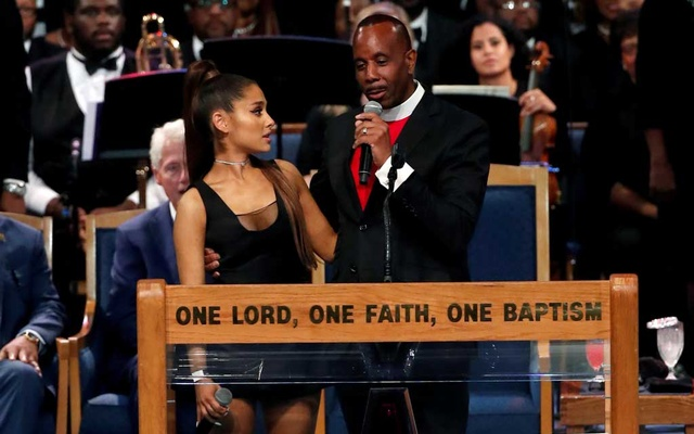 Pastor Charles Ellis speaks as he stands with singer Ariana Grande after she performed at the funeral service for Aretha Franklin at the Greater Grace Temple in Detroit, Michigan, US, Aug 31, 2018. Reuters