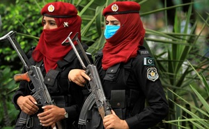 Female police force members stand guard during the protest by opposition parties supporters against, what they say is alleged, rigging by the Election Commission of Pakistan (ECP), during the general election, in Islamabad, Pakistan Aug 8, 2018. Reuters