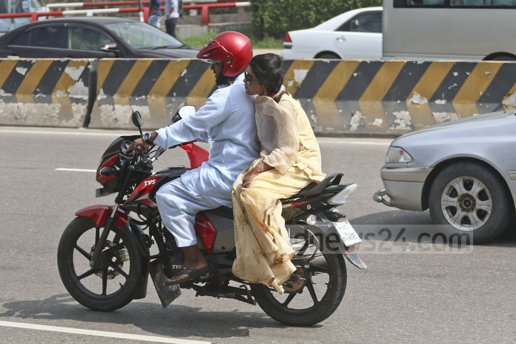 A motorcycle rider travelling without a helmet amidst strengthened monitoring by the law enforcers in Dhaka. This photo was taken from the Airport Road on Monday. Photo: Abdullah Al Momin