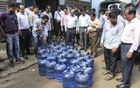 Water jars are being destroyed in an anti-adulteration drive. Photo: Asif Mahmud Ove