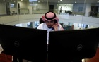 A Saudi trader observes the stock market on monitors at Falcom stock exchange agency in Riyadh, Saudi Arabia February 7, 2018. REUTERS/Faisal Al Nasser