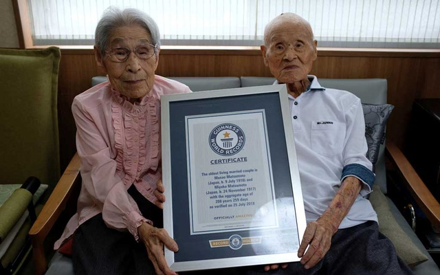 World's oldest living married couple Masao Matsumoto and Miyako Matsumoto poses with the Guinness World Record certificate at a nursing house in Takamatsu, Kagawa prefecture, Japan Sep 4, 2018. Reuters