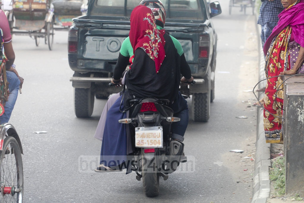 Many motorcyclists are not following the rules of using Bangla number plate. Photo: Asif Mahmud Ove