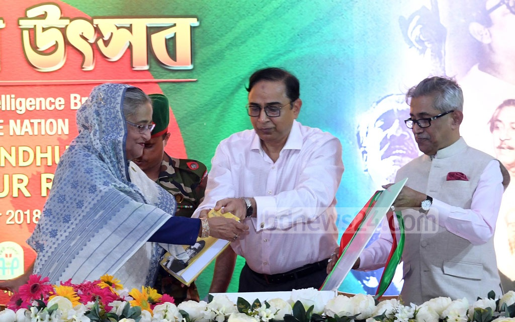 Prime Minister Sheikh Hasina unveils the first volume of the book 'Secret Documents of Intelligence Branch on Father of the Nation Bangabandhu Sheikh Mujibur Rahman' on Pakistani detectives' reports on him at the Ganabhaban in Dhaka on Friday. Photo: PID