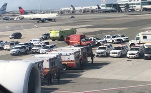 The emergency services are seen, after the passengers were taken ill on a flight from New York to Dubai, on JFK Airport, New York, US, Sep 05, 2018. Reuters