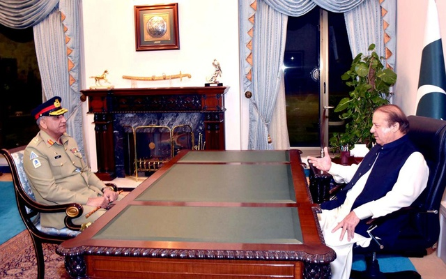 File Photo: Pakistan's Prime Minister Nawaz Sharif (R) talks with Qamar Javed Bajwa, Pakistan's newly designated Army Chief, at the Prime Minister's House in Islamabad, Pakistan, November 26, 2016. PID/Handout via REUTERS