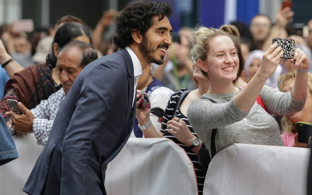 Actor Dev Patel meets with fans as he arrives for the world premiere of Hotel Mumbai at the Toronto International Film Festival (TIFF) in Toronto, Canada, Sep 7, 2018. REUTERS