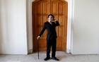 Afghanistan's Charlie Chaplin, Karim Asir, 25, reacts before his performance in Kabul, Afghanistan Aug 29, 2018. Reuters