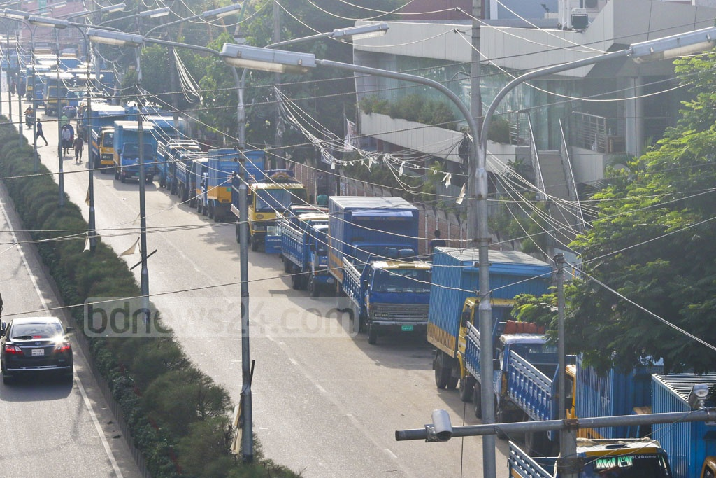 Parked pickups and covered vans are again blocking part of Tejgaon's Truck Stand Road. Photo: Abdullah Al Momin