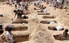 Yemenis digging graves for children killed when their school bus was hit during an air strike by the Saudi-led coalition in August. The New York Times