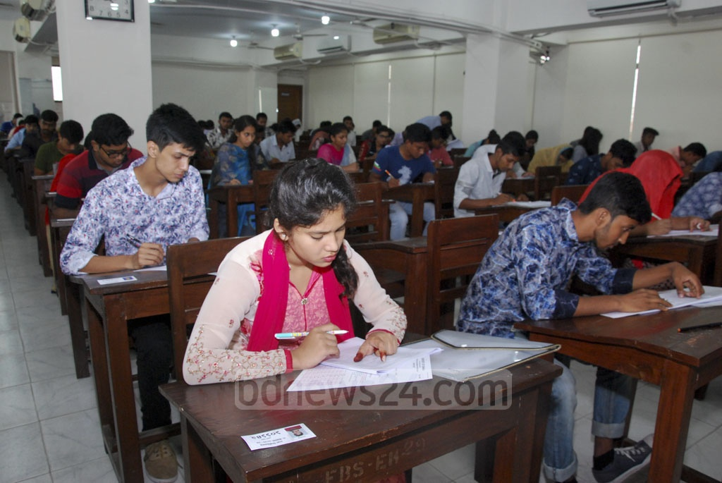 Students writing answers during Dhaka University's 'Ga' unit admission tests for the Faculty of Business Studies.