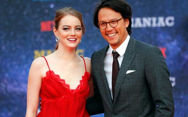Actor Emma Stone and director Cary Fukunaga attend the world premiere of the Netflix mini-series