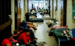 People are seen inside a shelter run by Red Cross before Hurricane Florence comes ashore in Grantsboro, North Carolina, US, Sep 13, 2018. Reuters
