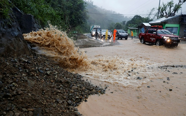 Motorists drive past a partially damaged road after Typhoon Mangkhut hit the main island of Luzon, in Carranglan, Nueva Ecija,Philippines, September 15, 2018.