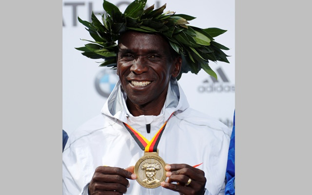 Athletics - Berlin Marathon - Berlin, Germany - Sept 16, 2018 Kenya's Eliud Kipchoge celebrates with a medal after winning the Berlin Marathon and breaking the World Record. Reuters