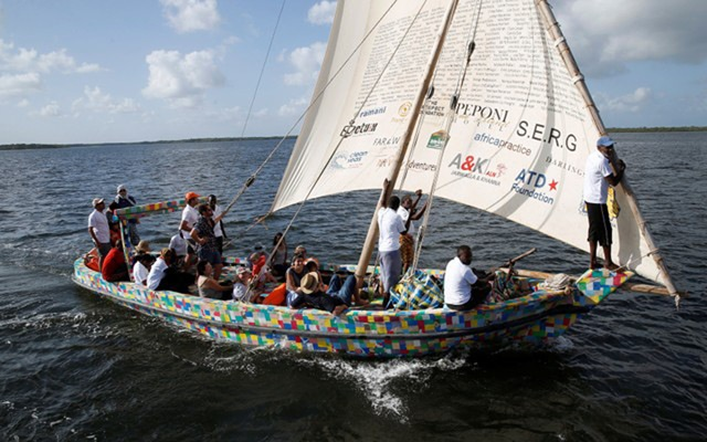 People take part in the first voyage sail of Flipflopi, the first dhow boat made entirely of recycled plastic, after the launch ceremony on the island of Lamu, Kenya, September 15, 2018.  Reuters