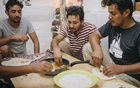 From left, Hesham al-Faieq, Hesham al-Omaisi and Abdulrahman al-Shargi, Yemeni asylum seekers, dine together at a guesthouse in northeast Jeju, South Korea, where they are staying temporarily, Jun 29, 2018. The arrival of hundreds of Yemenis has created a wave of opposition, leading to what is considered South Korea's first organised anti-asylum movement. Jun Michael Park/The New York Times