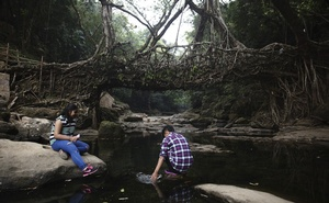 Tourists visit the living root bridge, a popular tourist attraction in Mawlynnong, India, Apr 2, 2018. Mawlynnong, a village in northeastern India, attracts throngs of visitors eager for a slice of village life, lush gardens and a tradition of cleanliness. Malin Fezehai/The New York Times