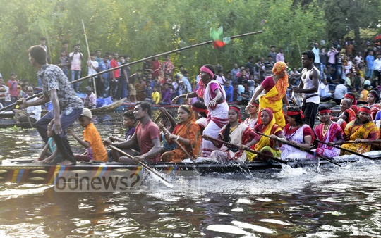 Women take part in a traditional boat race organised on the Babur Khal in Gopalganj's Kotalipara to celebrate Vishwakarma Puja on Tuesday.