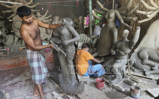 Ahead of Durga Puja, the largest festival for Hindus in Bangladesh, a craftsman is busy building the idol of the goddess in Dhaka's Banglabazar on Wednesday. Photo: Abdullah Al Momin