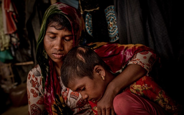 A Rohingya mother and her daughter, who fled the village of Min Gyi in Myanmar, at a refugee camp in Bangladesh last year. A United Nations panel cited the slaughter in Min Gyi last year in its report on the Myanmar military's crimes. The New York Times
