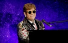 Singer Elton John performs before announcing his final