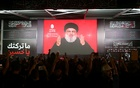 File Photo: Lebanon's Hezbollah leader Sayyed Hassan Nasrallah gestures as he addresses his supporters via a screen the night before Muslim Shi'ites around the world mark the day of Ashura, in Beirut, Lebanon Sept 19, 2018. Reuters
