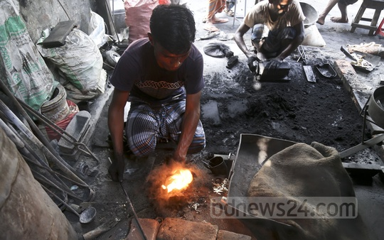 The sector is known as light engineering, but their work is anything but easy. The workers spend hours in sweltering factories in Old Dhaka, casting metals into products for daily use. Photo: Mahmud Zaman Ovi