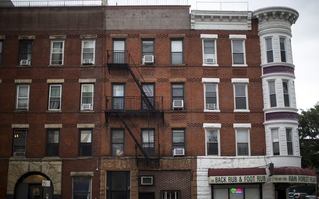 According to prosecutors, an apartment in this building, centre, in Park Slope, Brooklyn, was used as a brothel, Sep 14, 2018. The New York Times