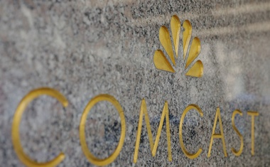 File Photo: The NBC and Comcast logos are displayed on 30 Rockefeller Plaza in midtown Manhattan in New York, US, Feb 27, 2018. Reuters