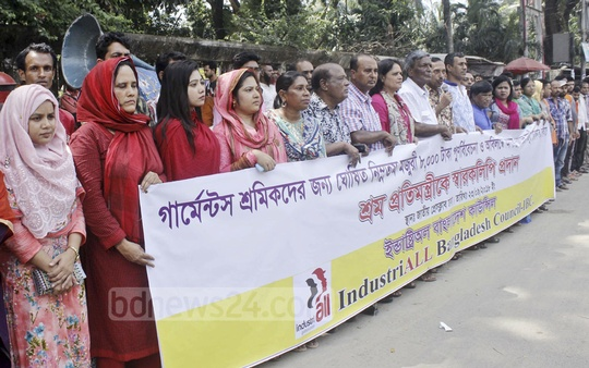 IndustriALL Bangladesh Council organised a human chain in front of the National Press Club in Dhaka on Sunday demanding revision of Tk 8,000 as minimum wage for readymade garment workers.