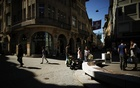 People walk in the old town of St Gallen, April 15, 2013. Reuters