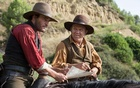 "Joaquin Phoenix and John C Reilly in ""The Sisters Brothers"". The New York Times"