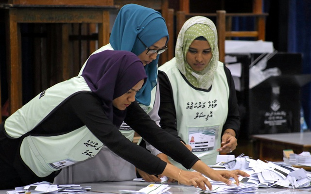 Maldives election commission officials prepare ballot papers for counting votes at a polling station at the end of the presidential election day in Male, Maldives September 23, 2018. Reuters