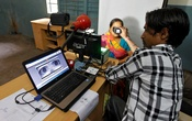 A woman goes through the process of eye scanning for Unique Identification (UID) database system in the outskirts of the western Indian city of Ahmedabad Feb 13, 2013. Reuters