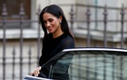 Britain's Meghan, the Duchess of Sussex, arrives at the opening of 'Oceania' at the Royal Academy of Arts in London, Britain Sep 25, 2018. Reuters