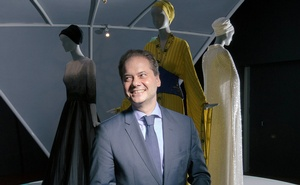 Max Hollein, with a design by Bill Gaytten for Christian Dior, and ones by Jean Paul Gaultier and Karl Lagerfeld, at the de Young Museum in San Francisco. The New York Times