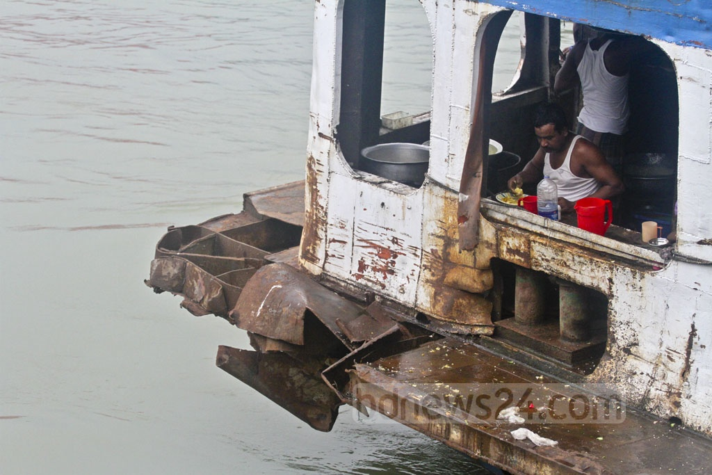 The 'Sampad' launch on the Dhaka-Dewanbari route continues to operate despite unrepaired damage from a collision with another launch. Photo taken at the Sadarghat on Saturday. Photo: Asif Mahmud Ove