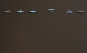 FILE PHOTO: Planes are surrounded by flood waters caused by Tropical Storm Harvey at the West Houston Airport in Texas, US, August 30, 2017. Reuters