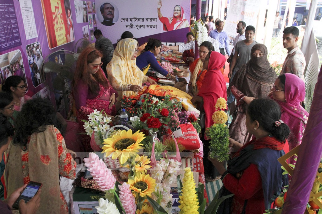 Visitors crowd a stall at the fourth National Development Fair in Dhaka on Thursday. Photo: Asif Mahmud Ove