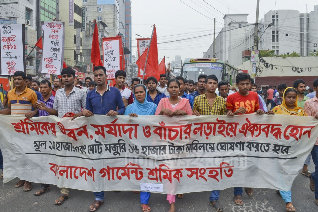 Bangladesh Garment Sramik Sanghati, a platform of workers, demonstrates in front of the National Press Club on Friday urging the government to review the new wage structure.